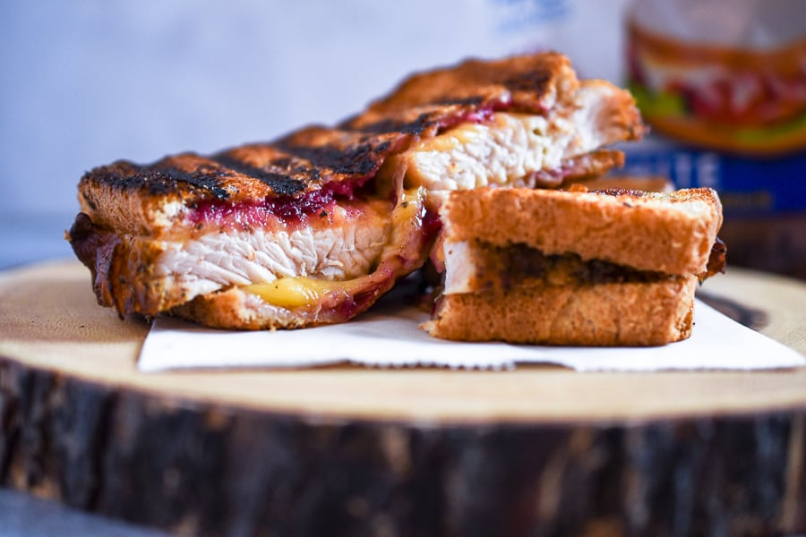 This Turkey Cranberry Panini Sandwich joins all your favorite Thanksgiving dishes into one delicious Panini Sandwich. Juicy, sliced turkey breast, cranberry sauce, and sliced gouda cheese combined into a panini.